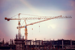 Construction site with cranes on sky background Stock Images