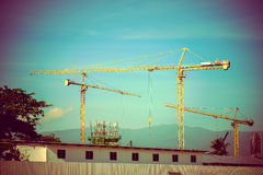 Construction site with cranes on sky background Royalty Free Stock Photos