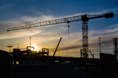 Construction site with cranes on sky background Royalty Free Stock Image