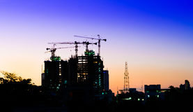 Construction site with cranes at sunset Royalty Free Stock Images