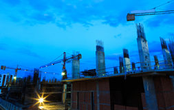 Construction site with cranes on twilight sky Royalty Free Stock Images