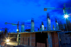 Construction site with cranes on twilight sky Royalty Free Stock Image