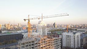 Construction site with cranes. Video. Construction workers are building. Aerial view. Top view of the construction site. In the city. Construction in the city stock footage