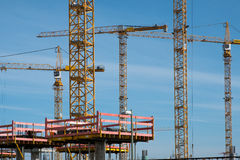 Construction site and cranes at work Stock Photography
