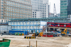 Construction site of Crossrail Place in Canary Wharf. London, UK - May 24, 2017 - Construction site of Crossrail Place in Canary Wharf with DLR train passing in Stock Photo