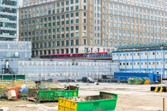 Construction site of Crossrail Place in Canary Wharf. London, UK - May 24, 2017 - Construction site of Crossrail Place in Canary Wharf with DLR train passing in Royalty Free Stock Photo