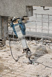 Construction site, demolishing with electric plugger Royalty Free Stock Photography