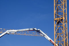 Construction site. Details of cranes and excavator Stock Images
