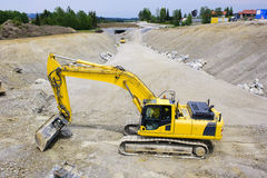 Construction site with digger Royalty Free Stock Photos