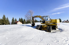 Construction site digger at winter snow Royalty Free Stock Images