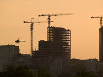 Construction site on dusk. Construction site urban cityscape with helicopter in the air on dusk Royalty Free Stock Images