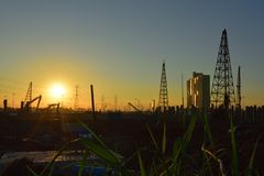 Construction site and electrical Pole with Sunrise sky.  Royalty Free Stock Photography