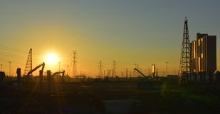 Construction site and electrical Pole with Sunrise sky.  Royalty Free Stock Image