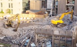 Construction site in england. Building site with heavy machinery knocking down a building to make way for something new Royalty Free Stock Photography