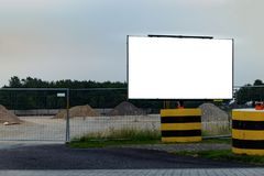 Construction site entrance with empty billboard banner mockup stock image