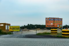 Krefeld 26th 2018: Construction site entrance with warning sign, saying that, nobody is allowed to enter and that they work safe royalty free stock photo