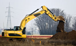 Construction site with escavator. Yellow heavy excavator on a construction site Stock Photos