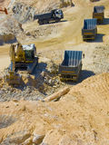 Construction site excavation. A fleet on earth moving vehicles on a construction site Stock Photo