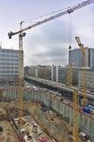 Construction site with excavation, crane, street, cars, traffic. Construction site with excavation, crane, street, cars, motor traffic Stock Photography