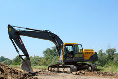 Construction site with excavator Royalty Free Stock Image
