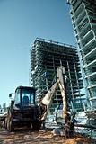 Construction site - excavator and scaffolds stock images