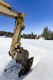 Construction site excavator working on snow Royalty Free Stock Images