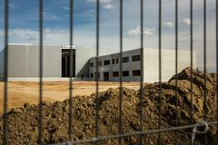 Construction site with a fence. Around it royalty free stock image