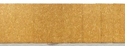 Construction site fence is made of wooden resin-impregnated chipboards. Construction site yellow fence is made of wooden resin-impregnated chipboards. Isolated stock images