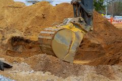 Construction site foundation with excavator working in excavation pit. Houses under construction ground industry sand earth dig soil industrial dirt land stock photos