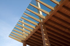Construction site: glued laminated timber. And mobile platform. Glued laminated timber, also called Glulam, is a type of structural timber product composed of royalty free stock photos