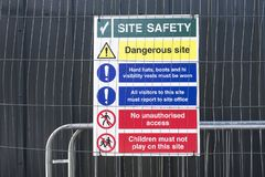 Construction site health and safety message rules sign board signage on fence boundary. Uk stock images