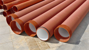 Construction site, heap of PVC tubes Royalty Free Stock Photography