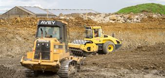 Construction Site with heavy excavating machinery Stock Photos