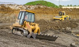 Construction Site with heavy excavating machinery Stock Image