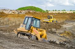 Construction Site with heavy excavating machinery Royalty Free Stock Images