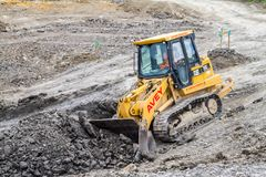 Construction Site with heavy excavating machinery Royalty Free Stock Image