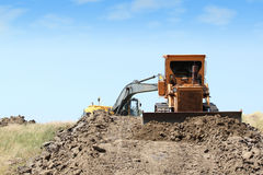 Construction site with heavy machinery Stock Images