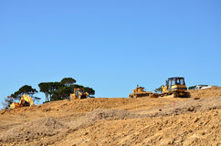 Construction site. Heavy machinery on a construction site stock images
