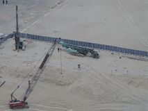 Industrial machines on a construction work site, aerial view. royalty free stock photos