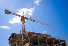 Construction site with a high crane Royalty Free Stock Image