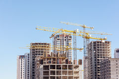 Construction site with high-rise unfinished apartment building a Stock Photo
