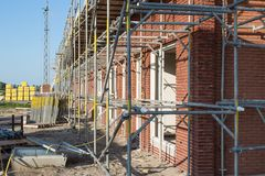 Construction site with houses in scaffolding Royalty Free Stock Photography