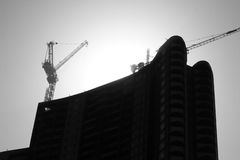 Construction site. Including steel structure and crane stock photography