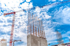 Construction site with industrial crane and close up of reinforced concrete walls, building of skyscraper building Royalty Free Stock Photography