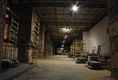 Construction Site Interior-At night. A closed construction site interior at night with scaffolds and material located in Moscow, Russia Stock Photo