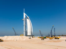 Under construction site, Jumeirah beach in Dubai. Cranes and work in progress on under construction site near Burj al Arab Hotel, Jumeirah Beach in the city of Stock Images