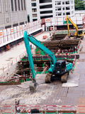 Construction site. Large track excavator work in construction site Royalty Free Stock Photography