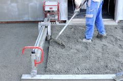 Construction site - machine running screed flooring Stock Image