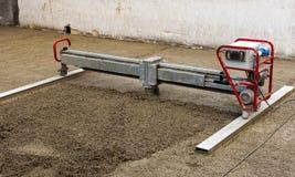 Machine running screed flooring. Construction site - machine running screed flooring Royalty Free Stock Image