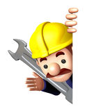 Construction site man holding a spanner Stock Photo